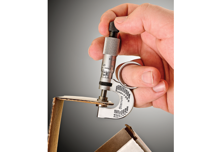 223RL Paper Gage Micrometer shown measuring cardboard box